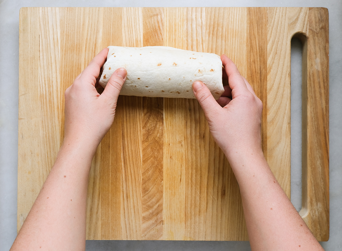 rolling up a burrito