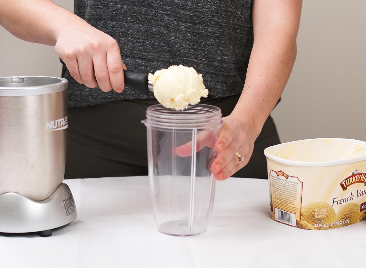 adding ice cream to a blender