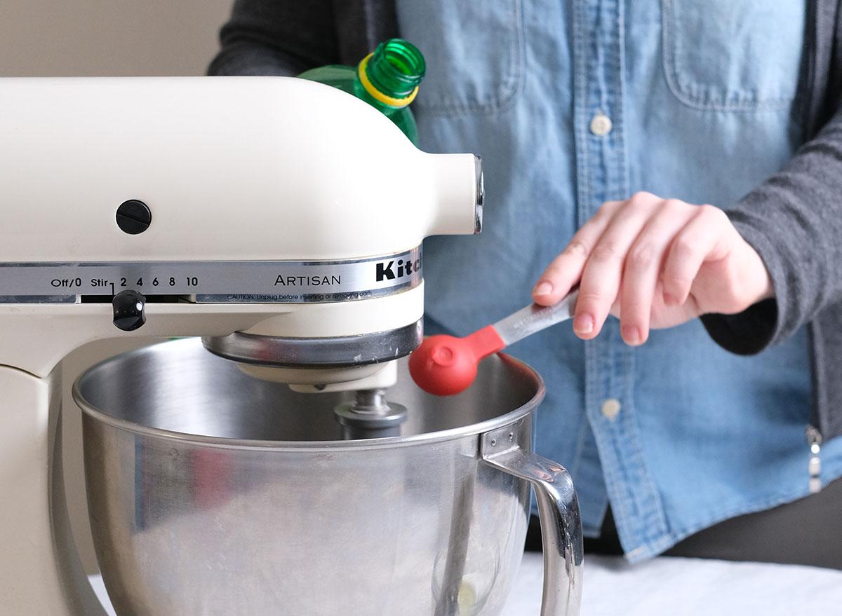 adding lemon juice to a stand mixer
