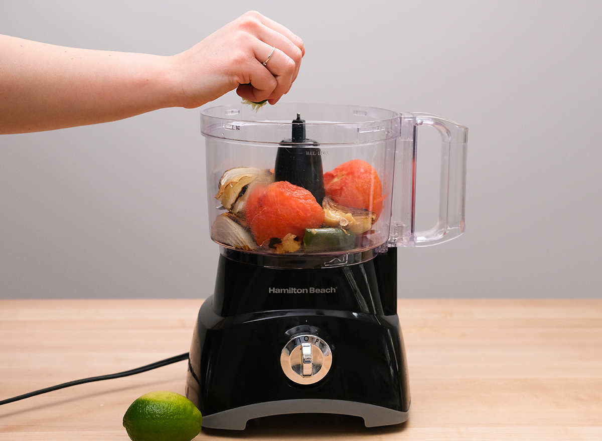 squeezing lime into a food processor