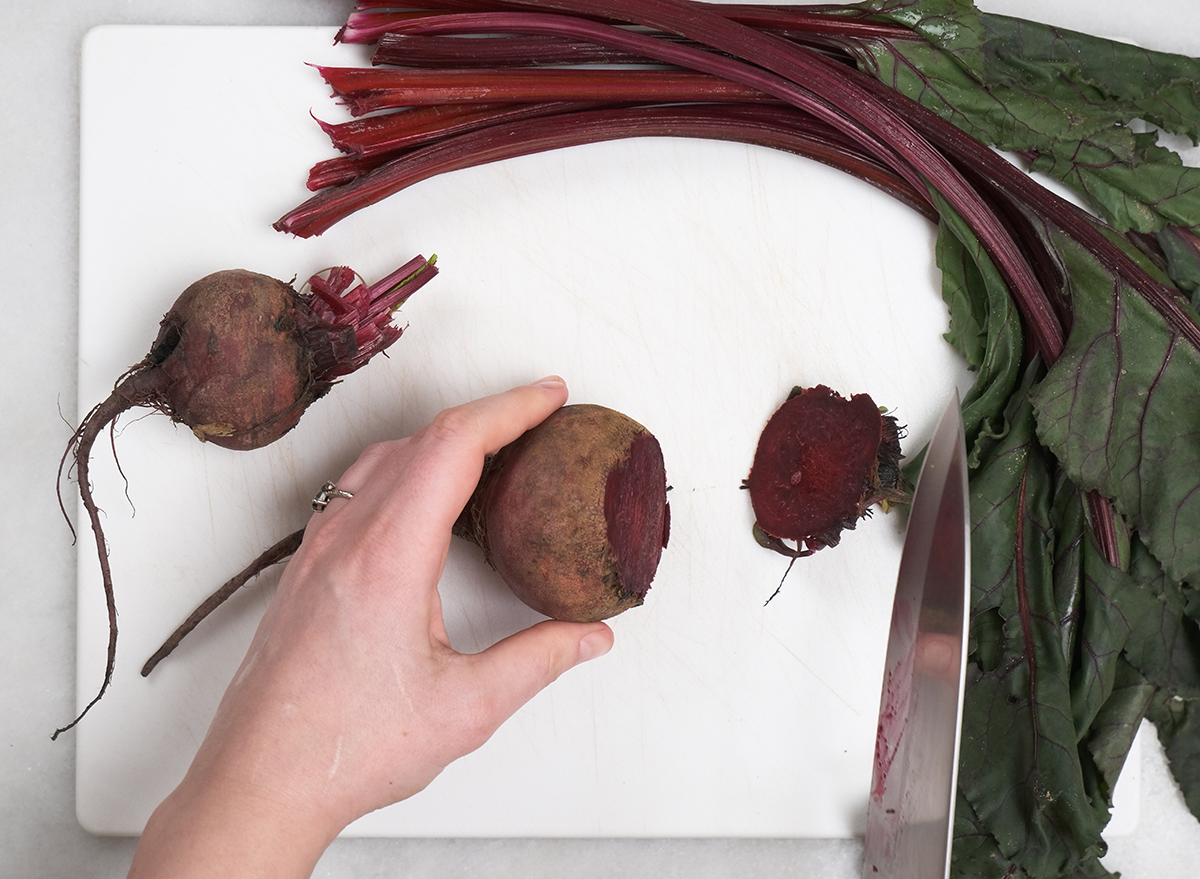 sliced bottom of a beet on a cutting board