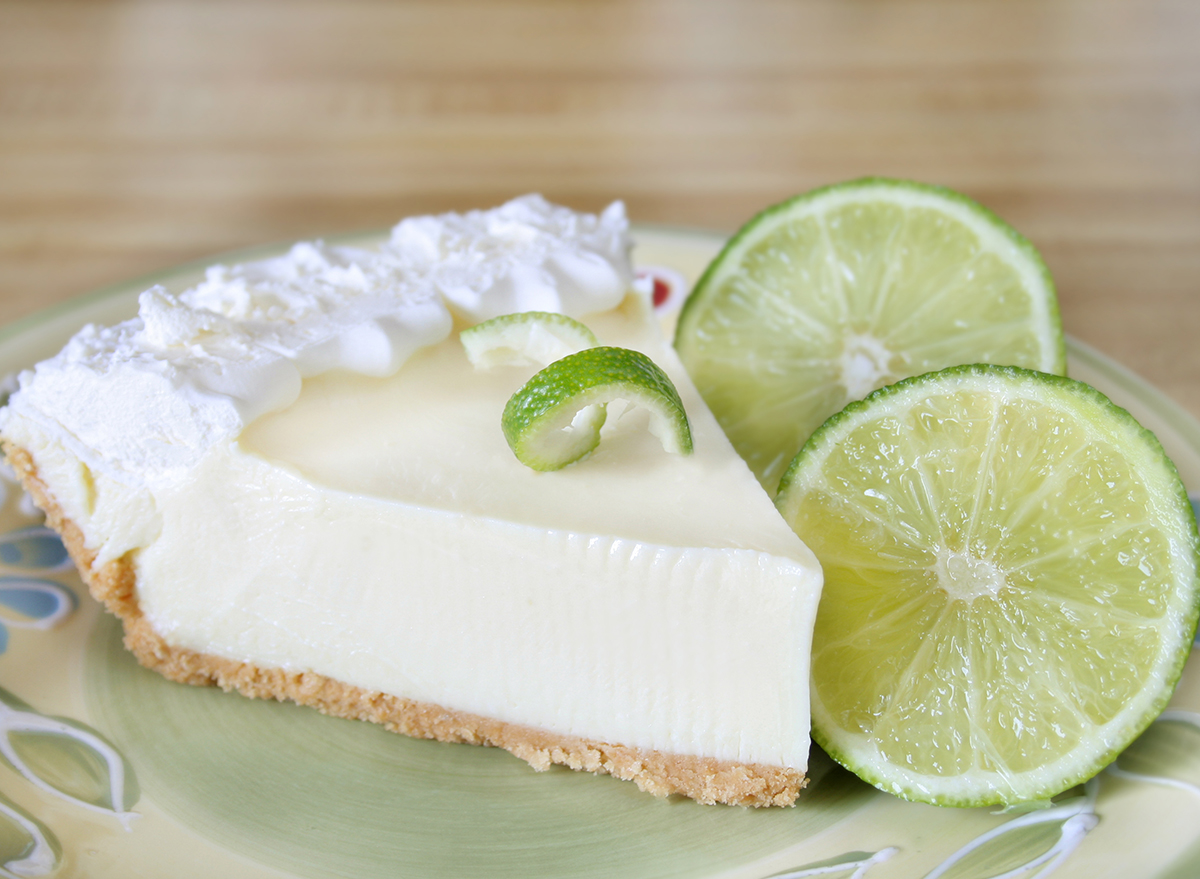 slice of key lime pie with fresh lime slices