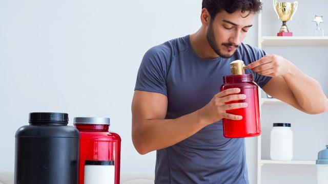 man using protein powder