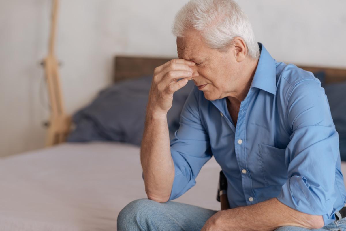 Moody aged man feeling unhappy.