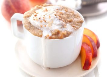 serving of peach cobbler oatmeal with peach slices