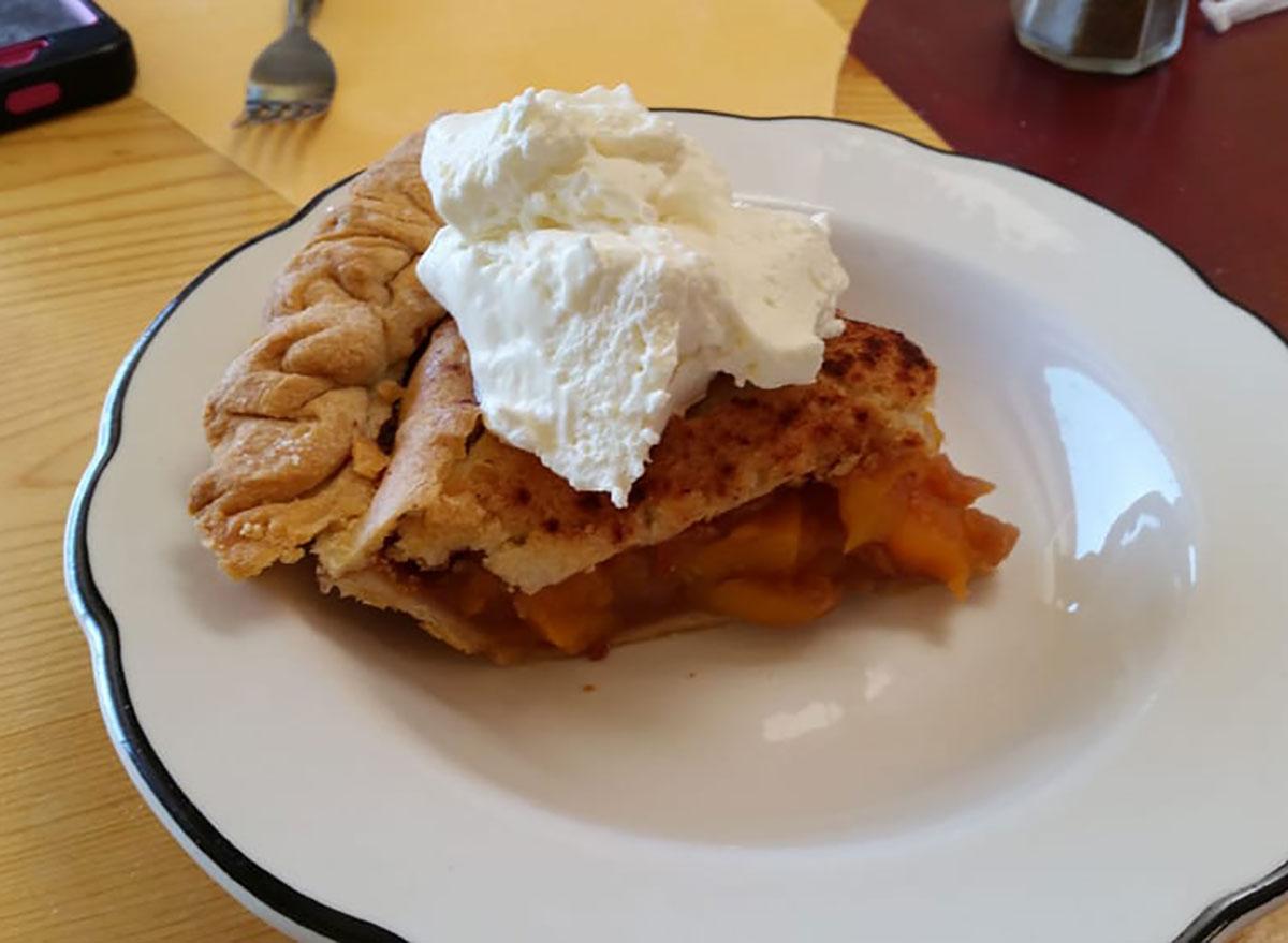 slice of peach pie on plate