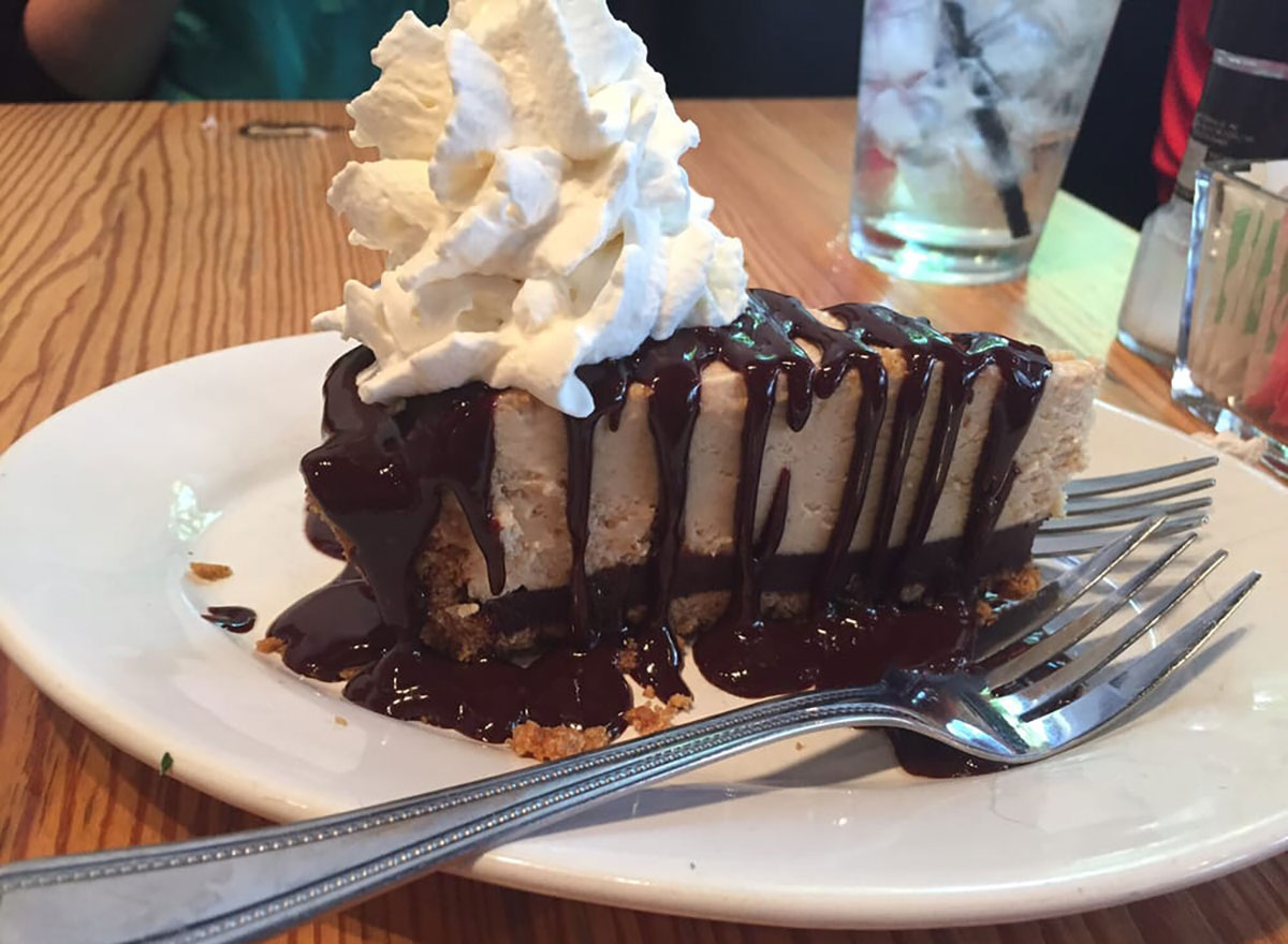slice of peanut butter pie with fudge and whipped cream