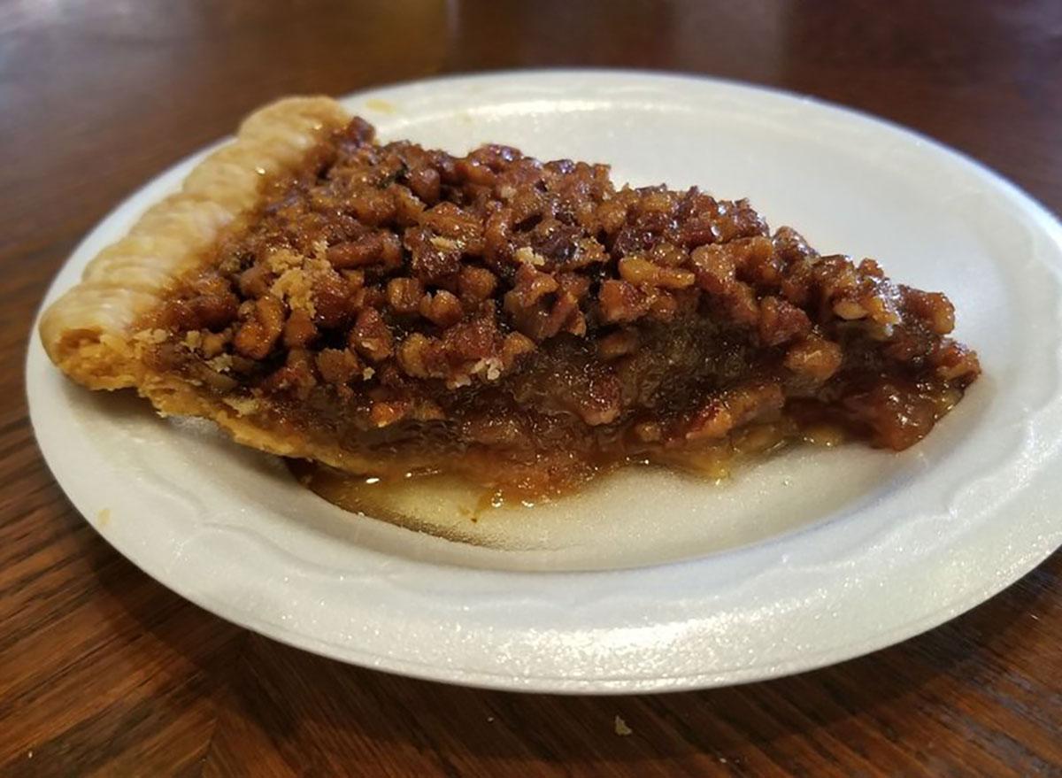 slice of pecan pie on styrofoam plate