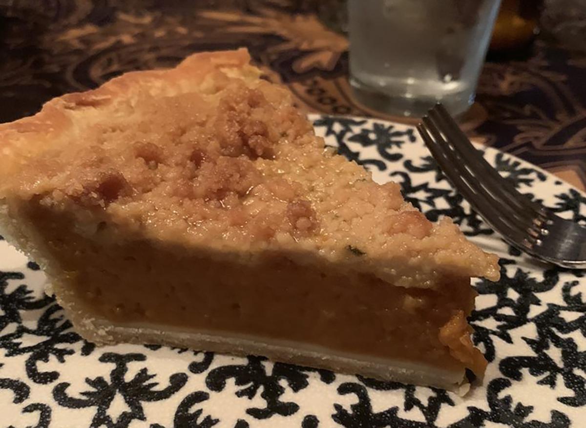 pumpkin pie slice with top crust