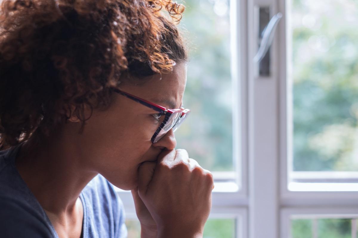 sad woman near window thinking