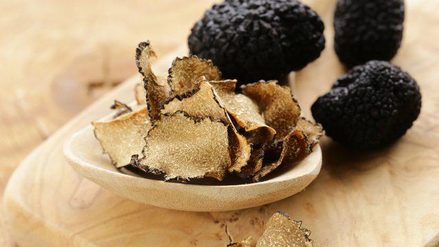 sliced truffle mushrooms on cutting board