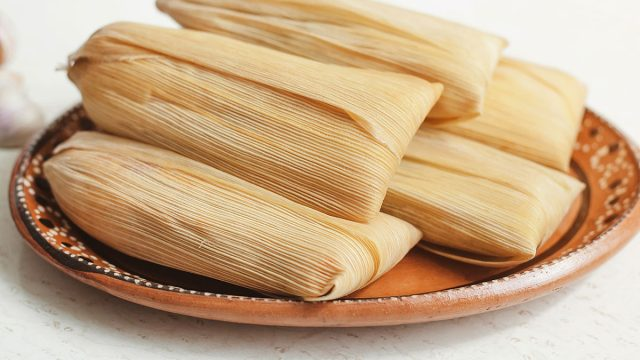 tamales piled on a plate