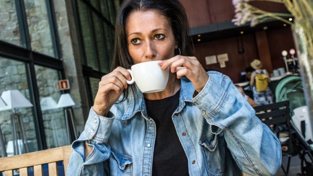 Stressed woman drinking coffee