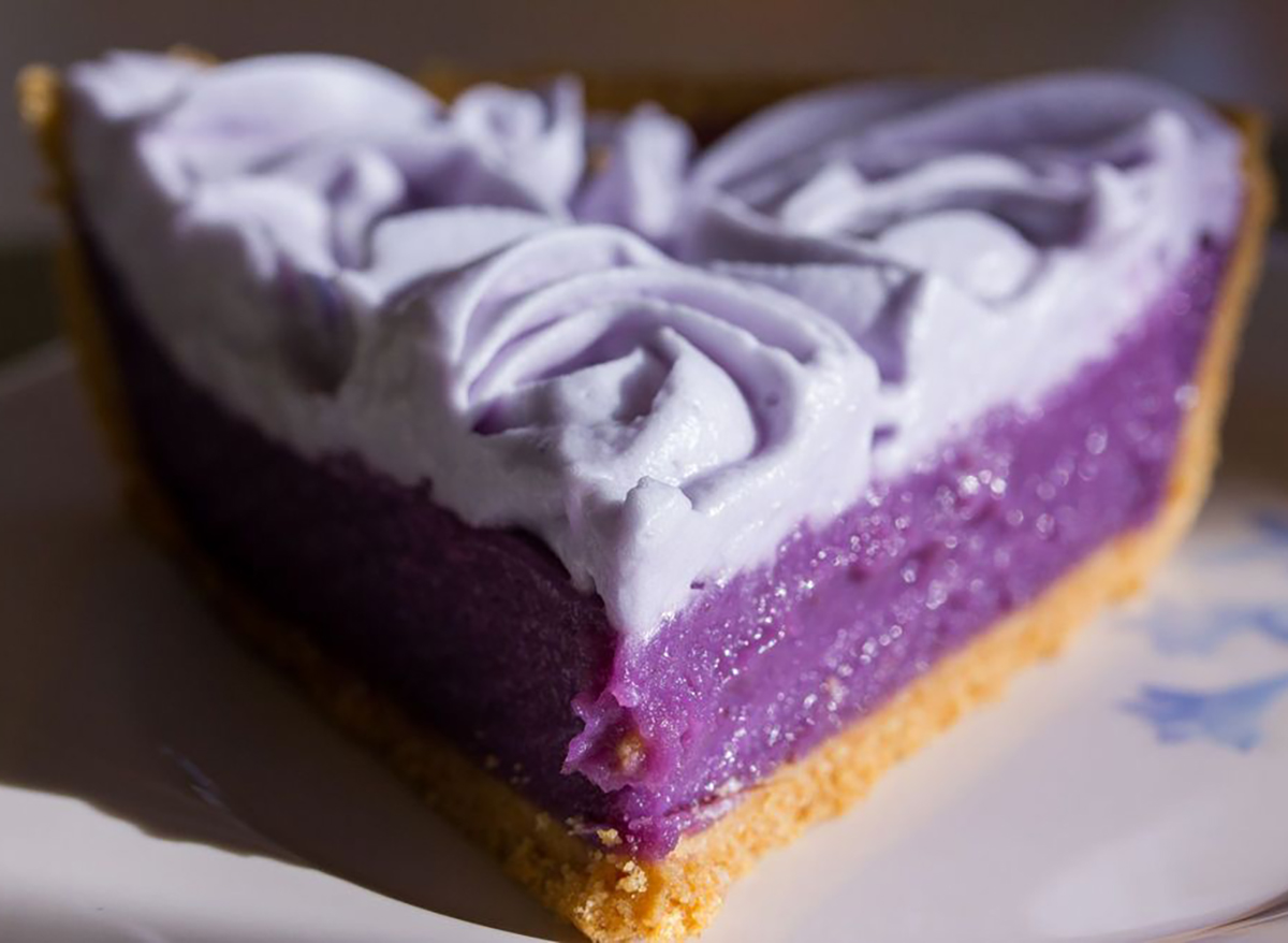 slice of ube pie with purple whipped cream
