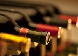 red wine bottles in a wine cellar