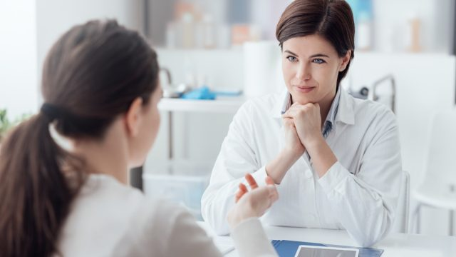 Doctor working in the office and listening to the patient