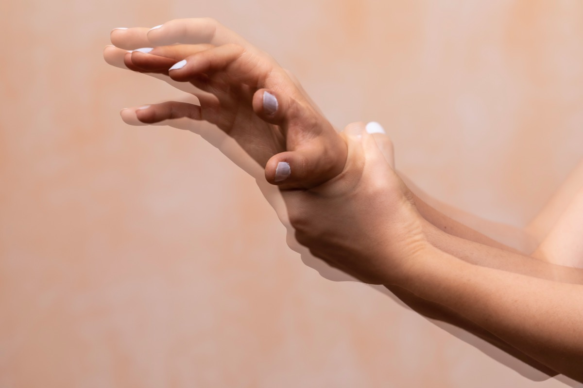 violently shaking hands of a PD sufferer (Parkinson's disease), tremors of the wrist and hand joints are the main symptom of the disorder