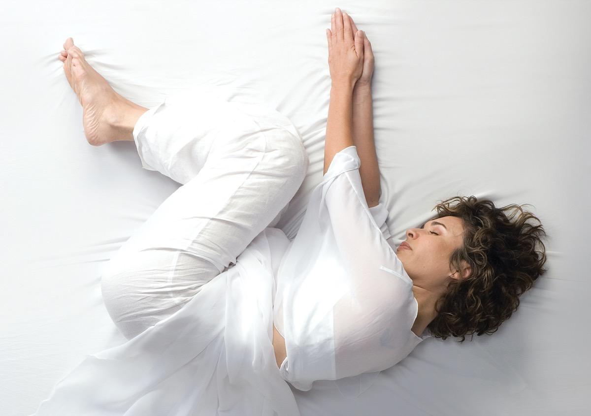 Woman in fetal position