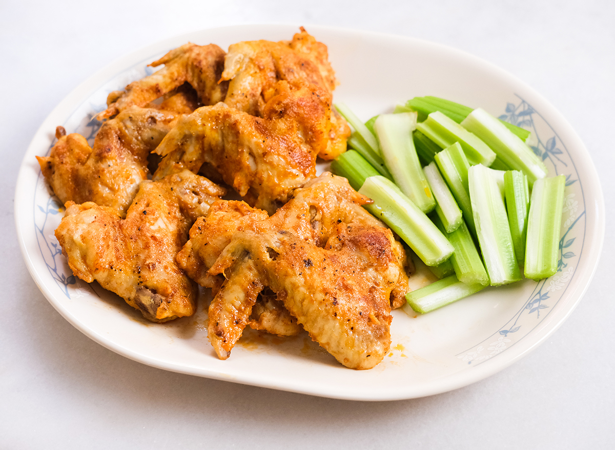 buffalo chicken wings and celery on a plate