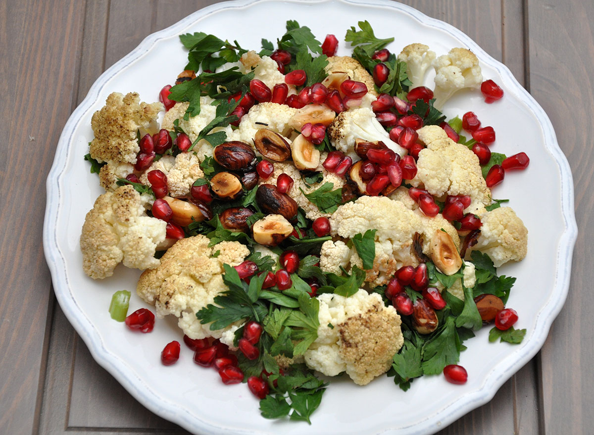 Vegetable salad with cauliflower, hazelnuts, and pomegranate seeds