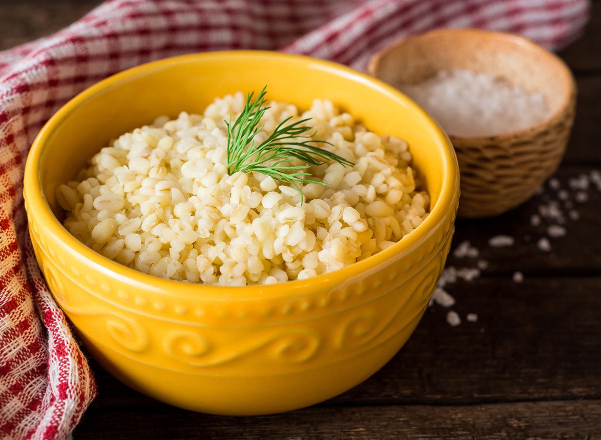 bulgur cooked in yellow ceramic bowl