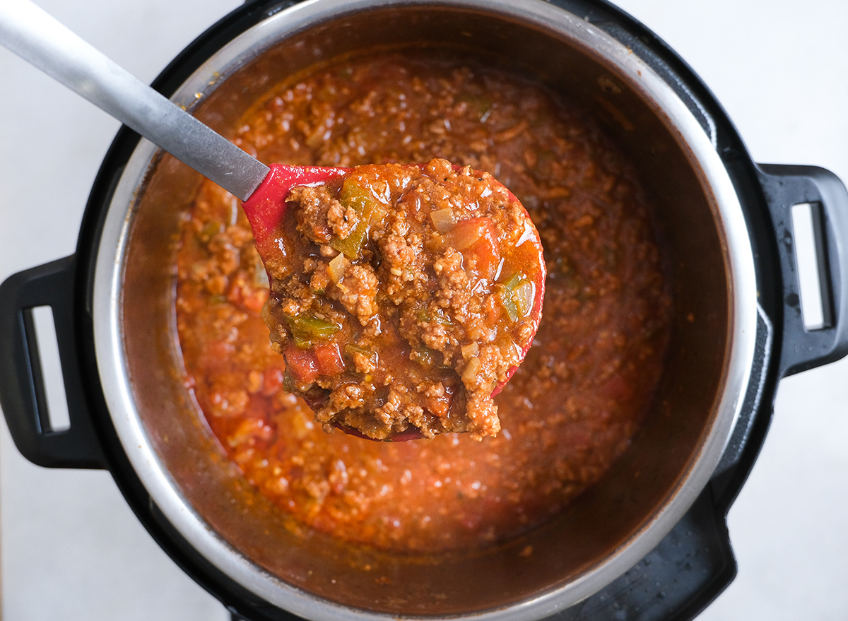 ladle full of chili from an Instant Pot