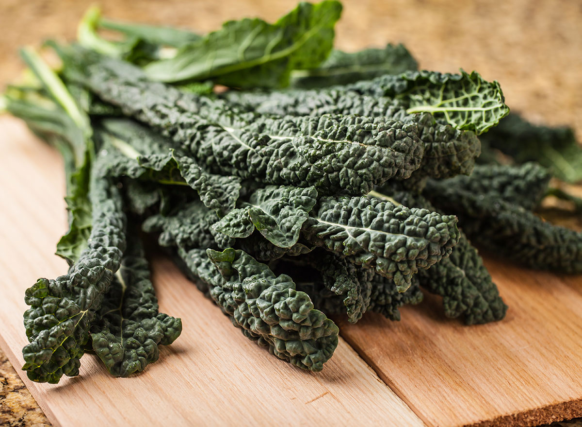 bunch of lacinato kale on wooden board
