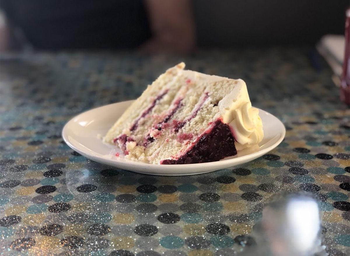 slice of lemon raspberry cake on white plate
