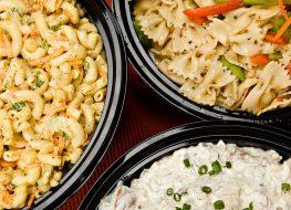 macaroni and potato salad served in black bowls