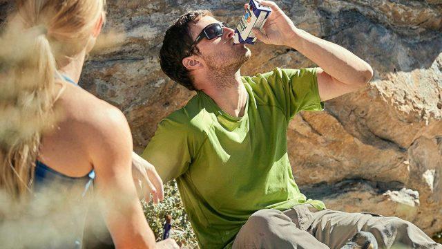 Man drinking orgain protein shake