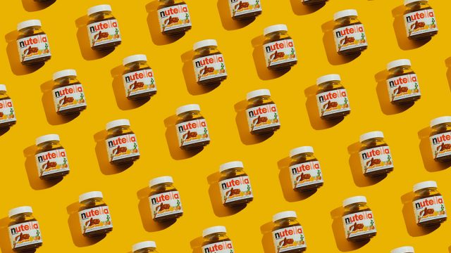 nutella jars with yellow background