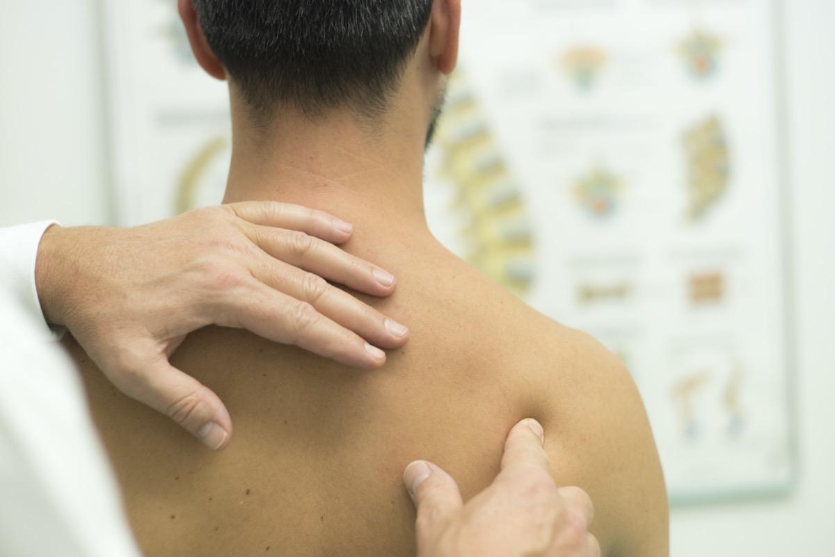 Medical check at the shoulder during a physiotherapy examination