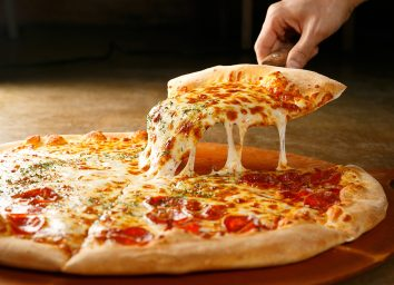 cheese pizza on wooden board
