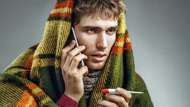 Sick cold man call phone illness flu thermometer