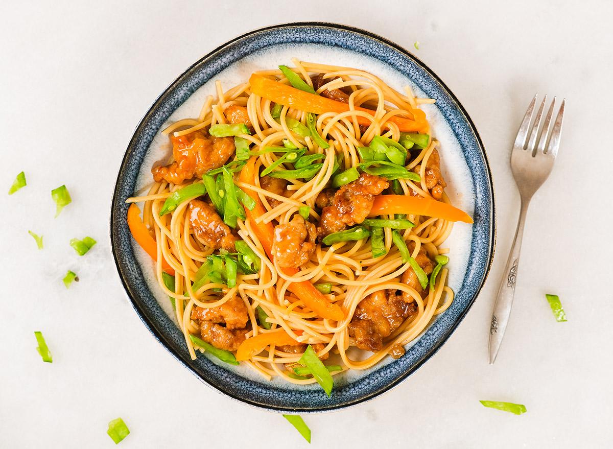 orange chicken pasta with fresh vegetables