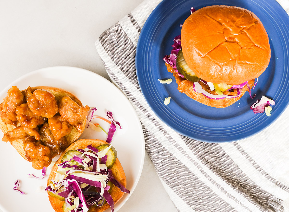 orange chicken sandwiches with pickles and slaw
