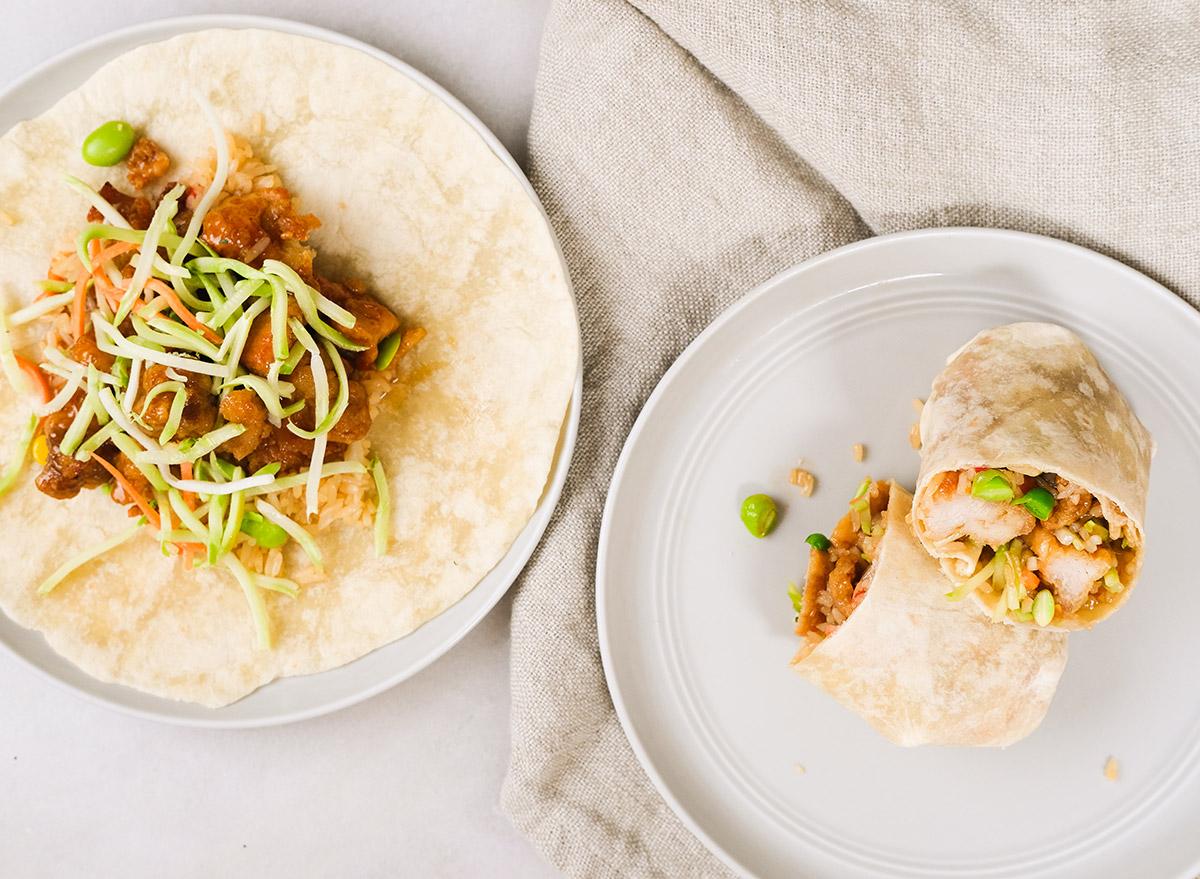 orange chicken burritos on grey plates