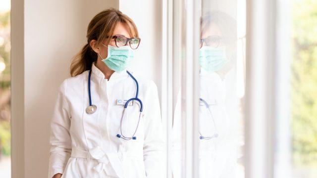 Woman doctor window stress sad fatigue