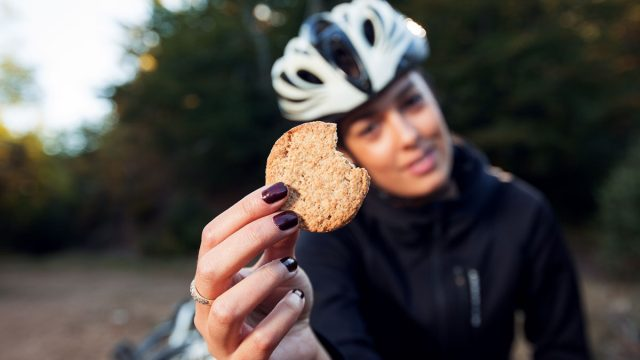 Woman eating protein cookie