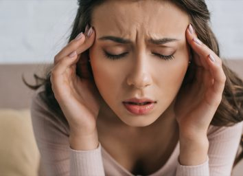woman with closed eyes suffering from headache