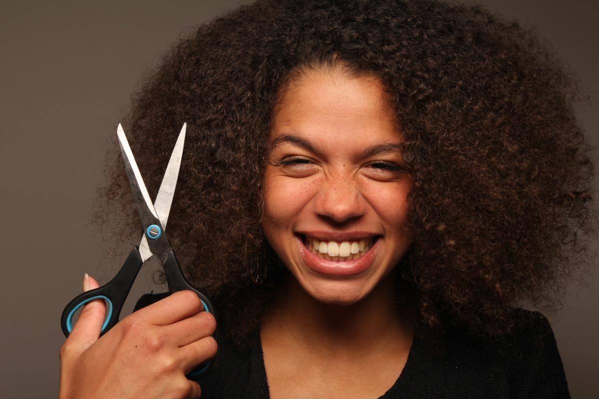 Beautiful afro women posing with scissor