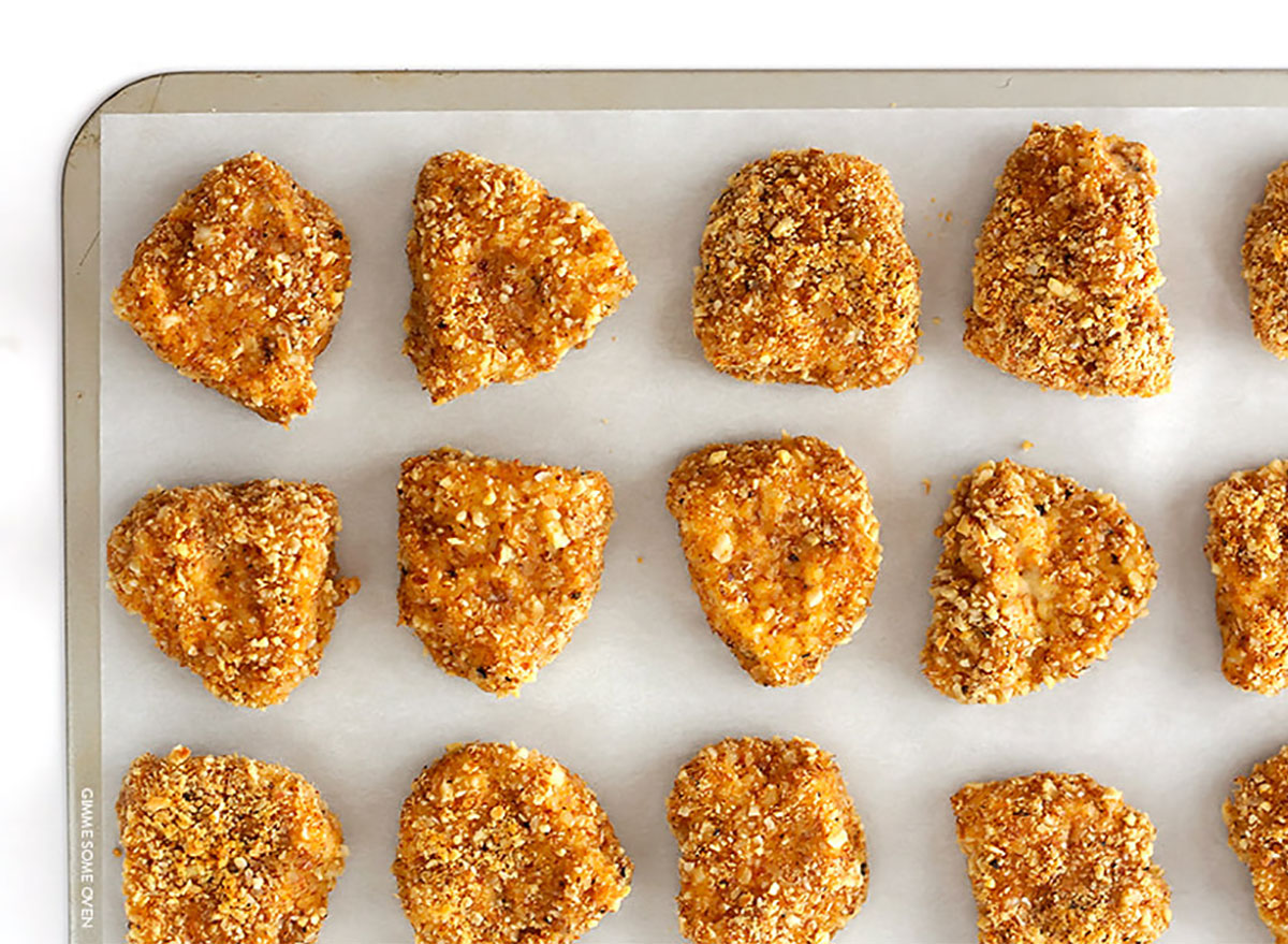 almond-crusted chicken nuggets on baking tray