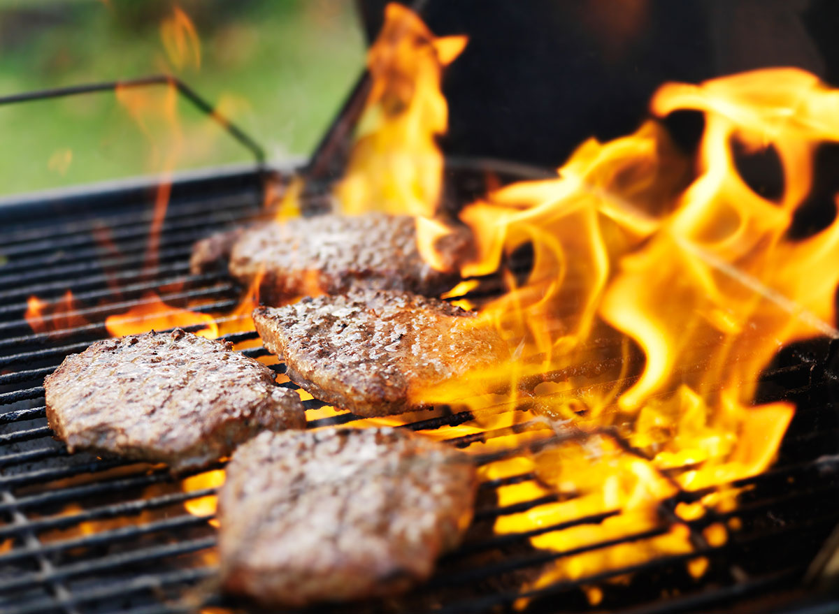 grilled burger surrounded by flare ups
