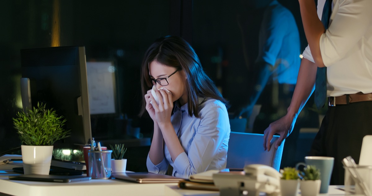 businesswoman is sick and cough while working
