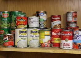 Assortment of Canned Goods on Shelf