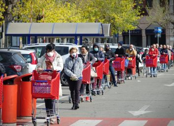 Coronavirus pandemic effects: long queue to enter the supermarket for grocery shopping