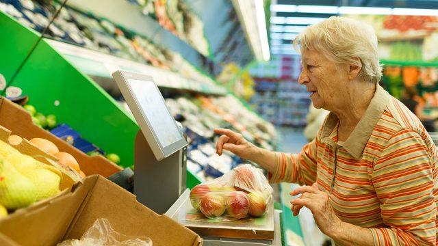 elderly woman grocery shopping