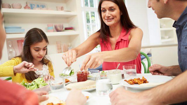 family of four eating dinner