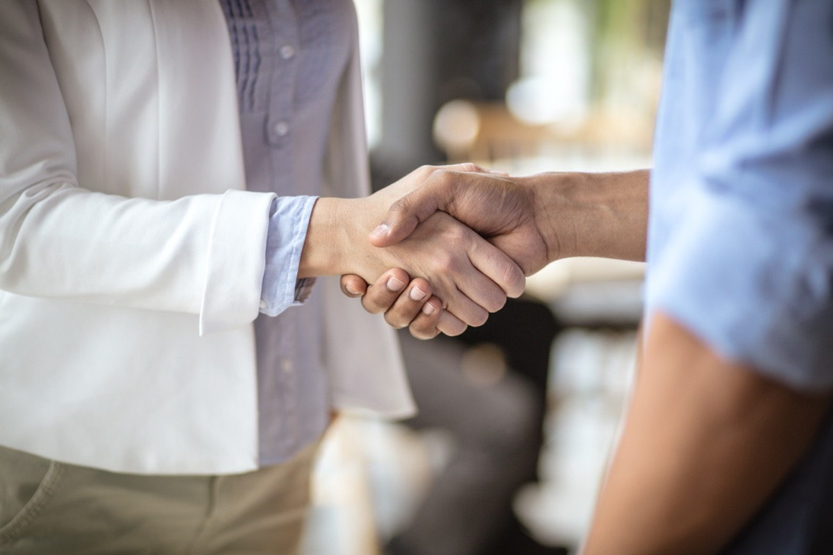 people shaking hands at office