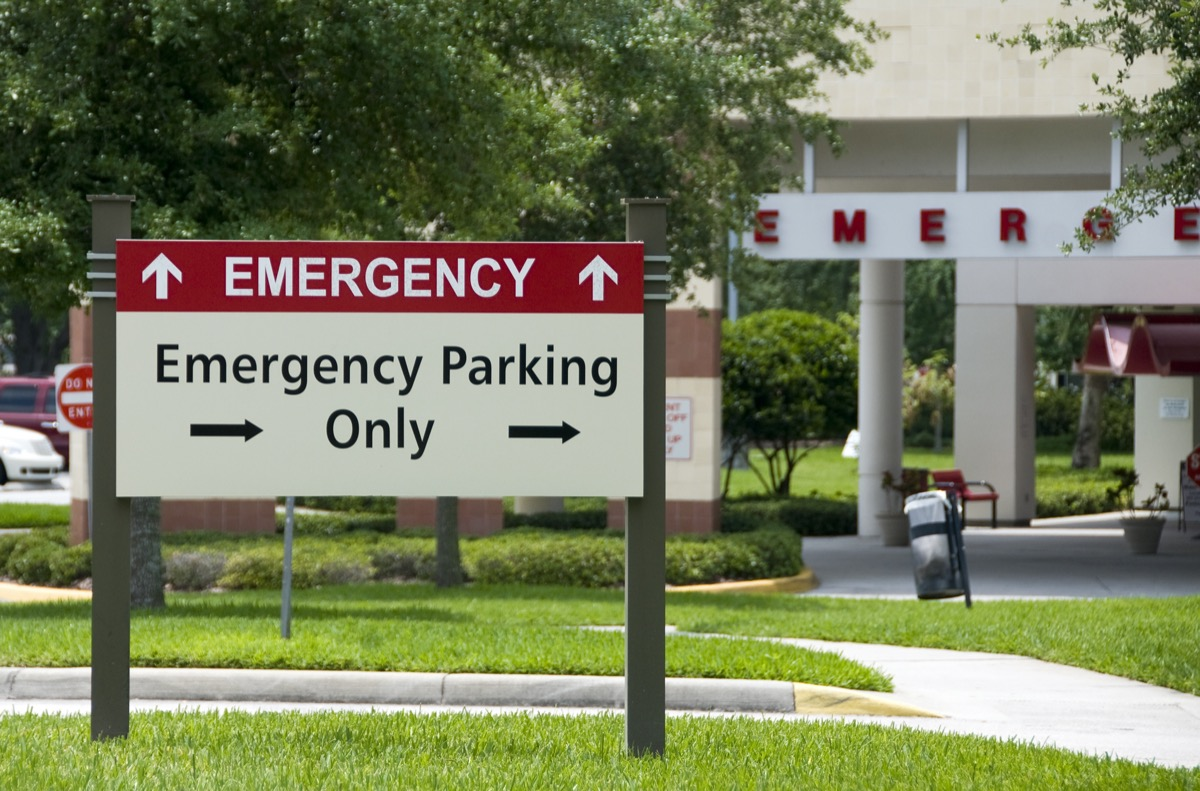 Hospital emergency entrance sign giving directions to emergency parking